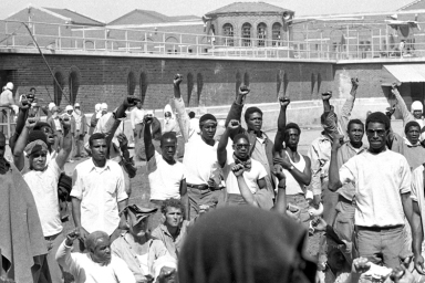 Inmates at Attica State Prison in Attica, N.Y., raise their hands in clenched fists in a show of unity, Sept. 1971, during the Attica uprising, which took the lives of 43 people. (AP Photo)